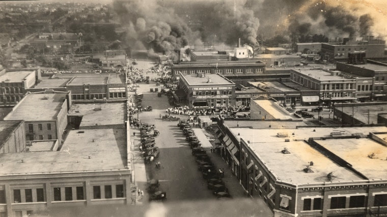 Crowds of people watching the fires on June 1, 1921 in Tulsa, Okla., looking from Cincinnati Ave. from 2nd St. to Detroit Ave.