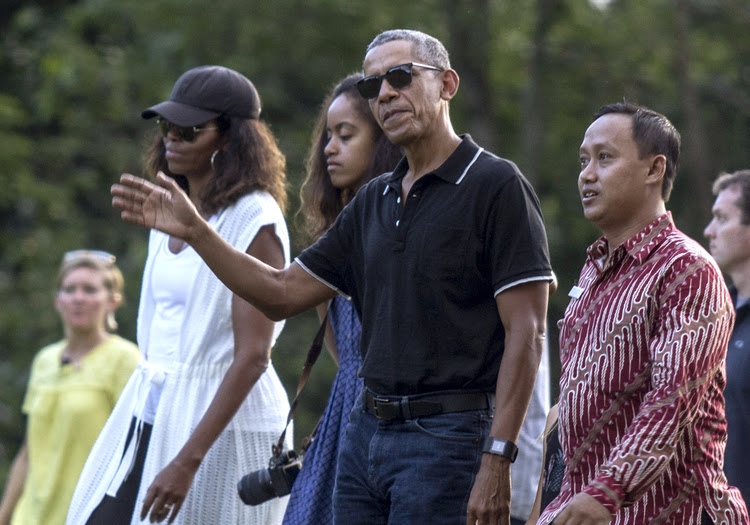 Barack Obama tours the Borobudur Temple in Central Java, Indonesia, with Michelle and Malia on June 28. (Slamet Riyadi/AP)