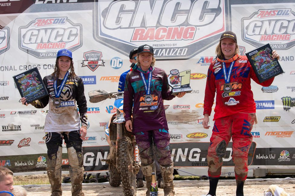 Becca Sheets (center), Mackenzie Tricker (right) and Rachael Archer (left) claimed the top three spots in the WXC class at the High Voltage GNCC.