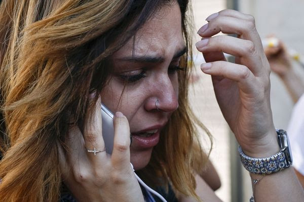 A woman cries after a vehicular attack on Las Ramblas in Barcelona on Aug. 17. (Pau Barrena/Agence France-Presse via Getty Images)