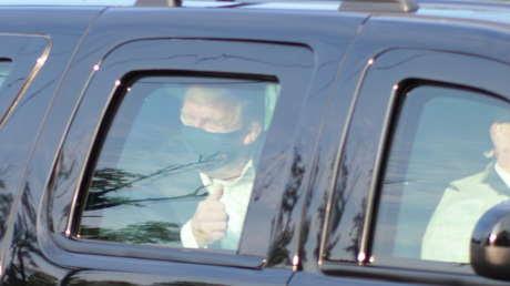 Trump da una vuelta en coche ante sus simpatizantes y recibe fuertes críticas por poner en riesgo la vida de otras personas