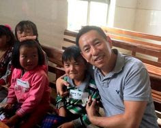 Eric Zhang with Miao Students. Eric suggested we help students in his home province, Yunnan.