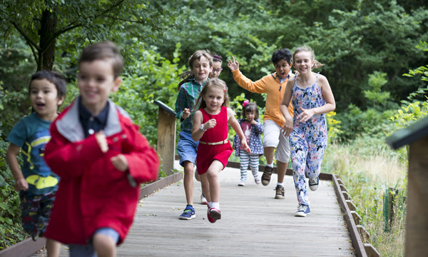 Children running in Kew's natural area