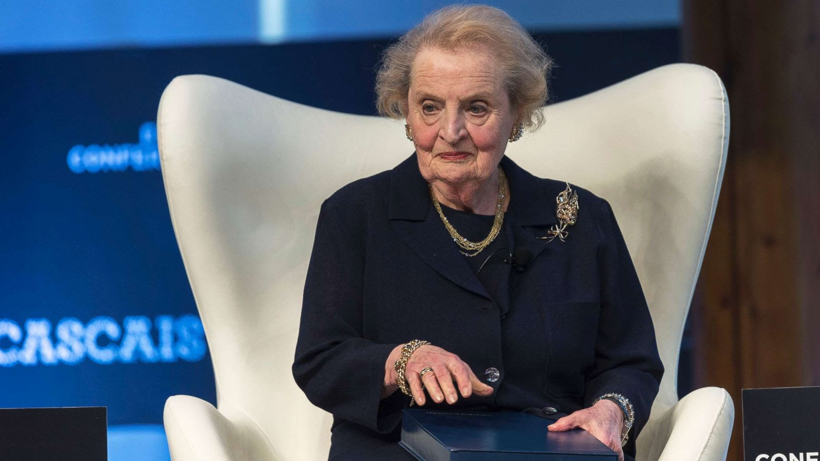 Madeleine Albright sitting in a chair on stage