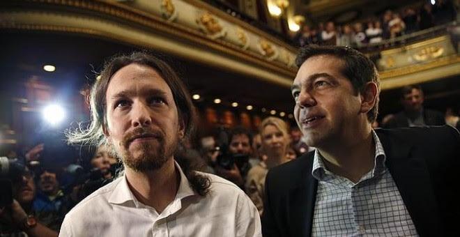 Pablo Iglesias y Alexis Tsipras, en un acto de Podemos en Madrid, en 2014.- REUTERS