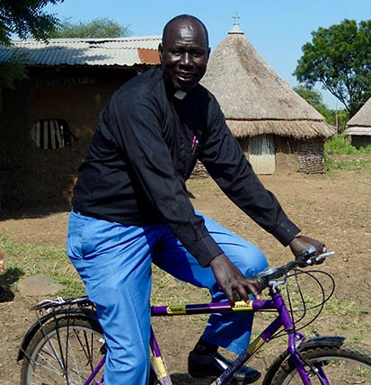 Rev. Simon Kerr on his new bicycle