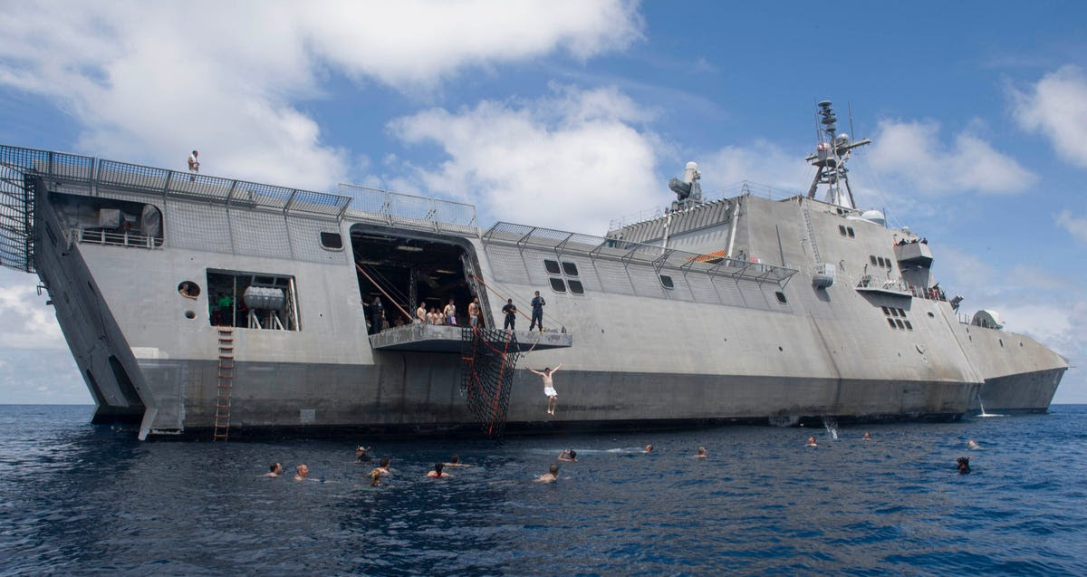 The US Navy may be the most professional in the world, with a very serious mission in the South China Sea, but they still make time for a swim on one of the US's newest combat ships, the USS Coronado.