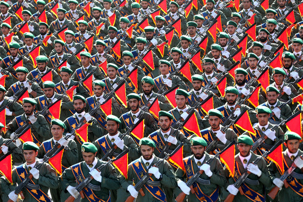 Iran's Revolutionary Guard troops march in a 2016 military parade in Tehran marking the 36th anniversary of Iraq's 1980 invasion of Iran. (Ebrahim Noroozi/Associated Press)</p>