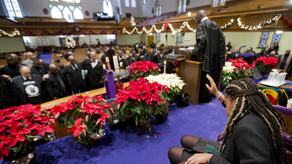 Pastor Rev. William Lamar IV leads his congregation in prayers, during a service at the Metropolitan AME Church in Washington, D.C., in 2014.