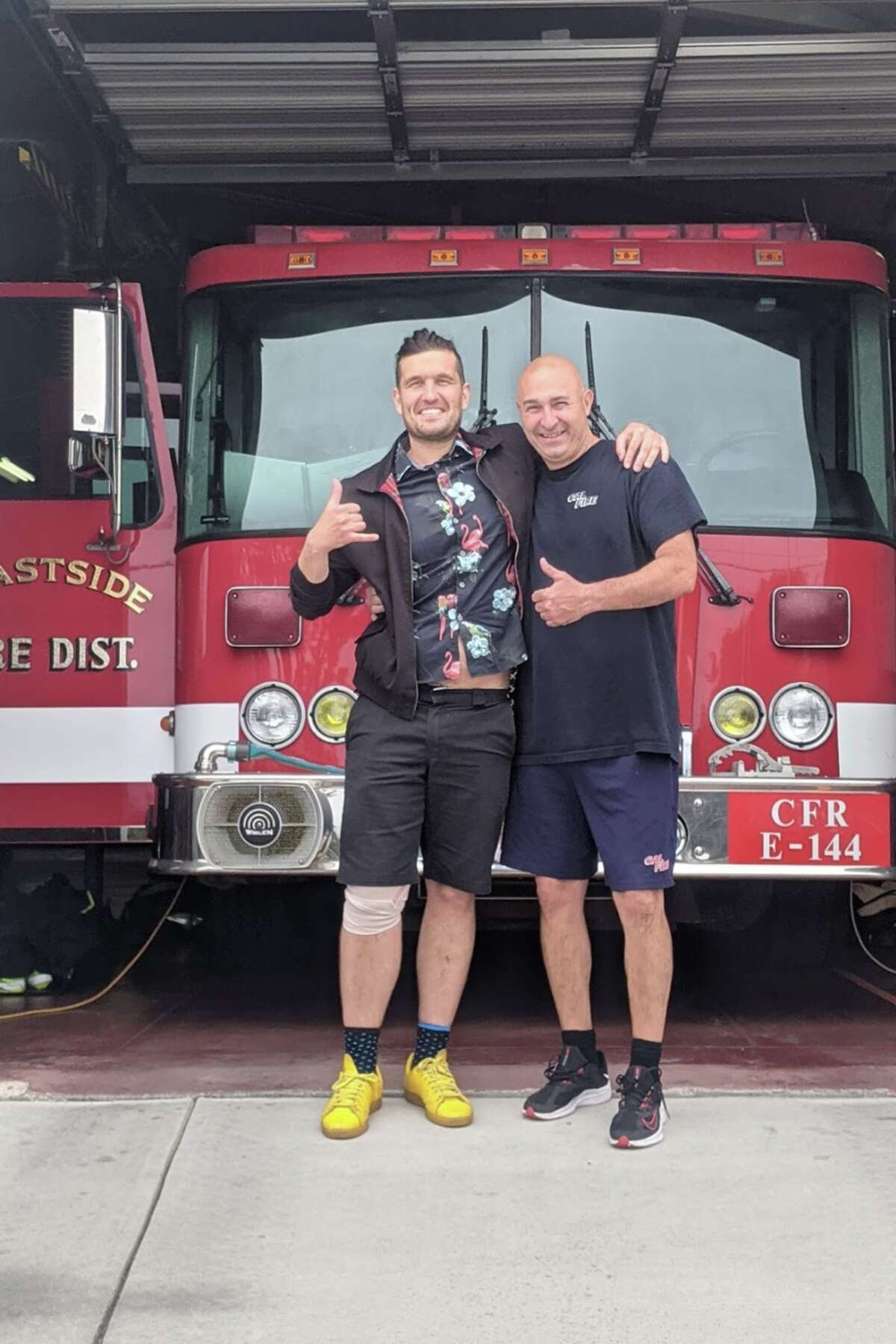 Nemanja Spasojevic, left, pictured a day after the shark encounter with Peter, who was the paramedic in charge from Montara Firestation 44.
