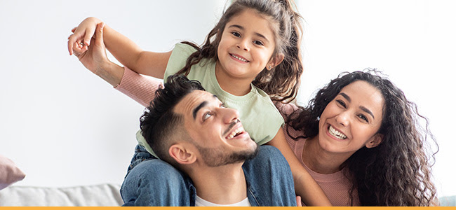 Smiling Family with Daughter
