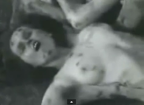 Woman's dead body with big breast and                               with irregular spots on her body with an                               open mouth (4min. 8sec.)