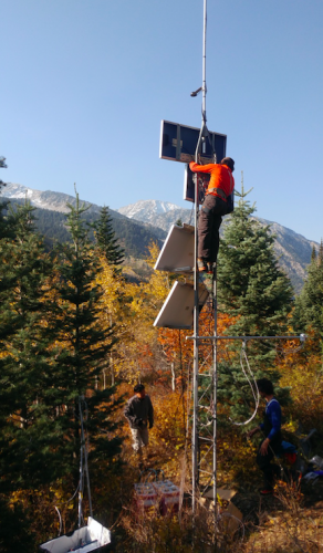 picture of geoscience professors installing equipment for avalache detection