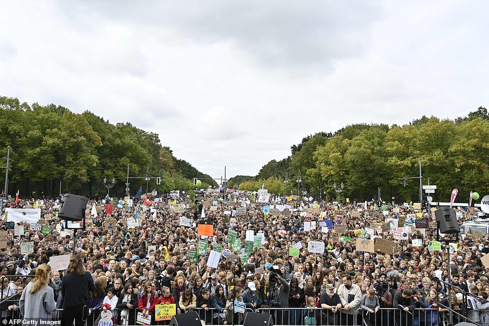 "Protesters attend the ""Fridays for Future"" demonstration at the Brandenburg Gate in Berlin"
