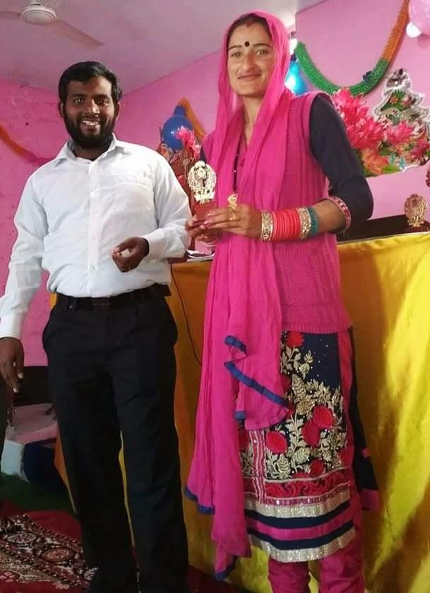 Seema Devi and Pastor Jeewer Joeswa after she won singing ward on Christmas Day. (Morning Star News)