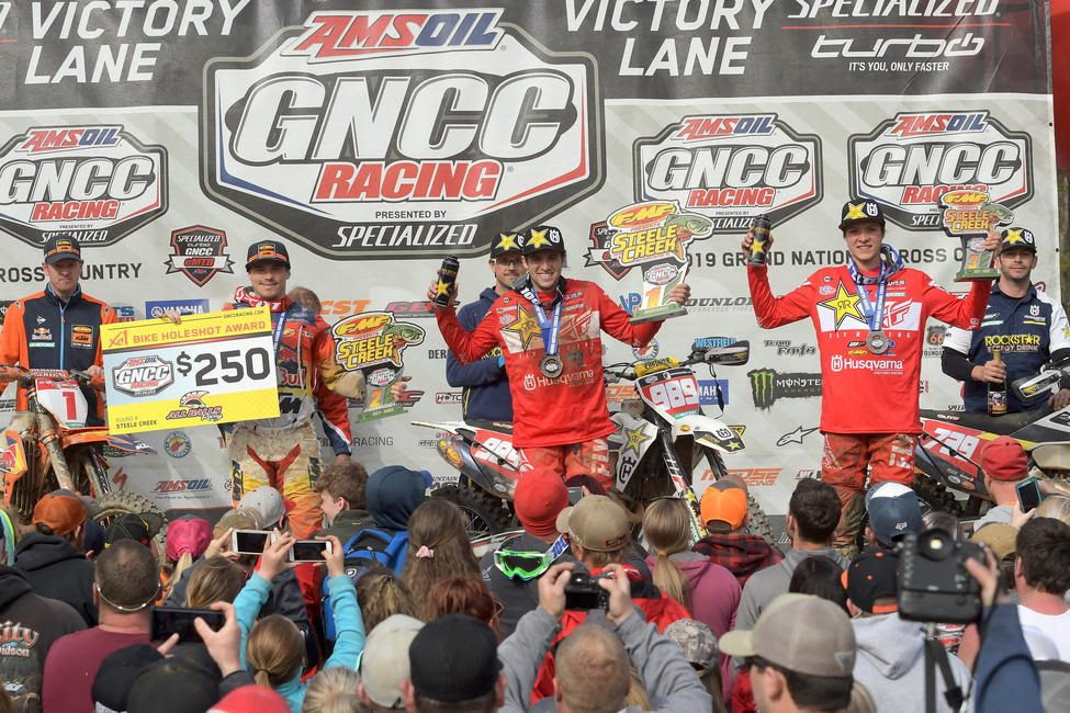 The 2019 top three Steele Creek GNCC overall finishers were: Thad Duvall (center), Kailub Russell (left) and Trevor Bollinger (right).