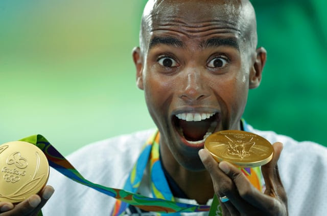 Olympics 2016 day fifteenMo Farah shows off his two gold medals earned in wins in the 10,000 and 5,000m after the ceremony for the mens 5,000m during day fifteen of the 2016 Olympics in Rio de Janiero on August 20th 2016 in Brazil (Photo by Tom Jenkins).