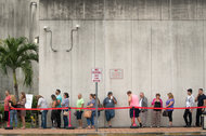 Early voters lined up outside the West Regional Library in the Westchester neighborhood in Miami.