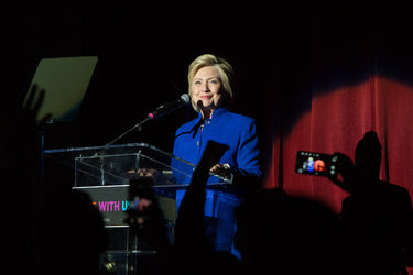 "Hillary Clinton appeared at the ""She's With Us"" concert in Los Angeles, after it was reported on Monday that she had exceeded the delegate threshold to become the presumptive Democratic nominee."