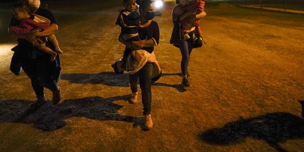 People crossing the border at night