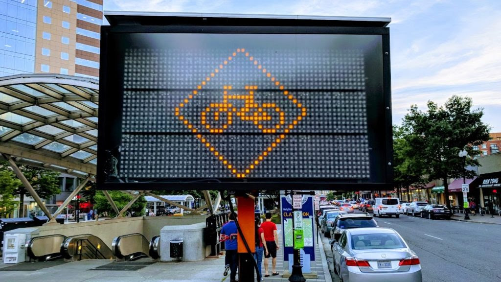 A digital road sign with a depiction of a bicycle on it