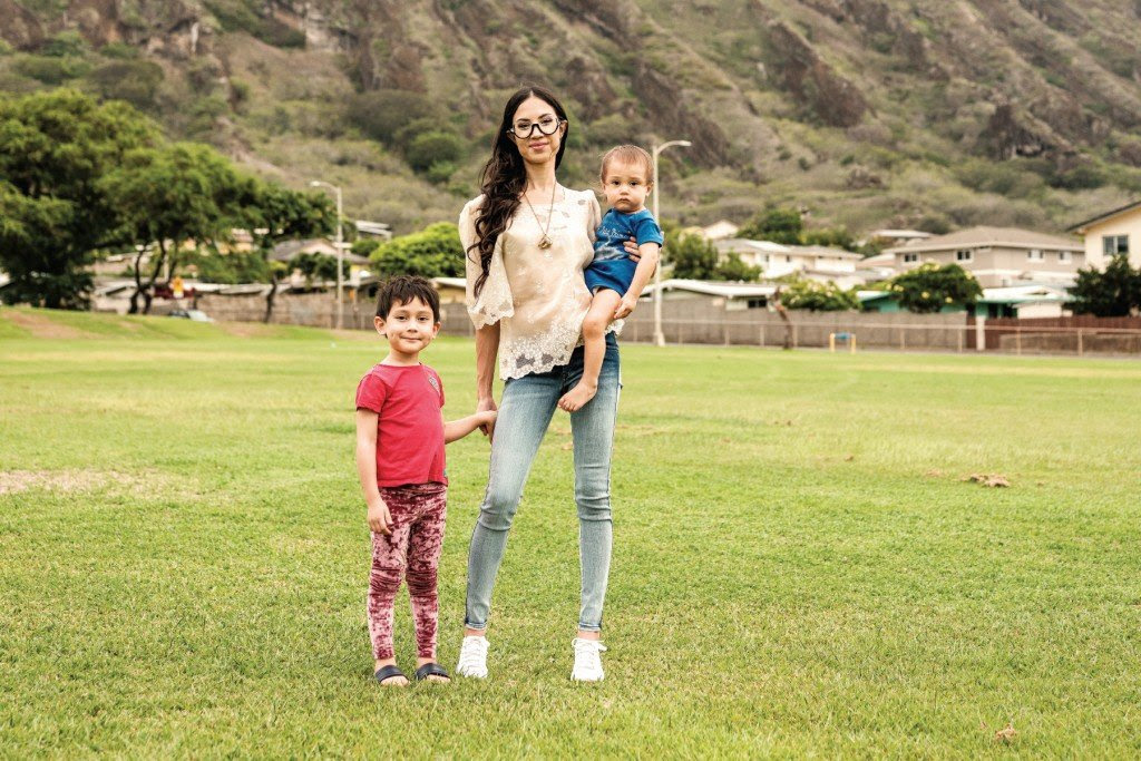 Khara Jabola Carolus, Executive Director of the Hawaiʻi State Commission on the Status of Women, with her kids. | Photo: Aaron Yoshino