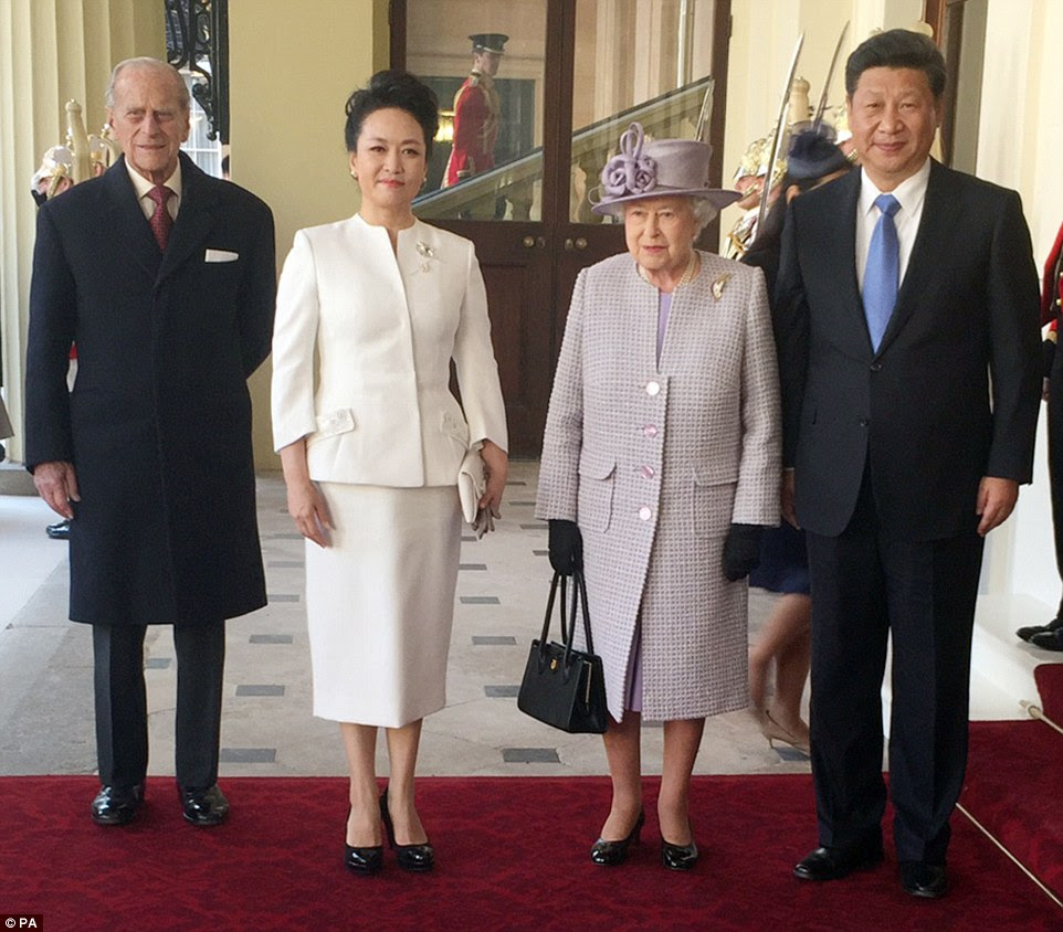 Pictured from left, Prince Philip, Madame Peng Liyuan, the Queen and President Xi at the grand entrance to Buckingham Palace
