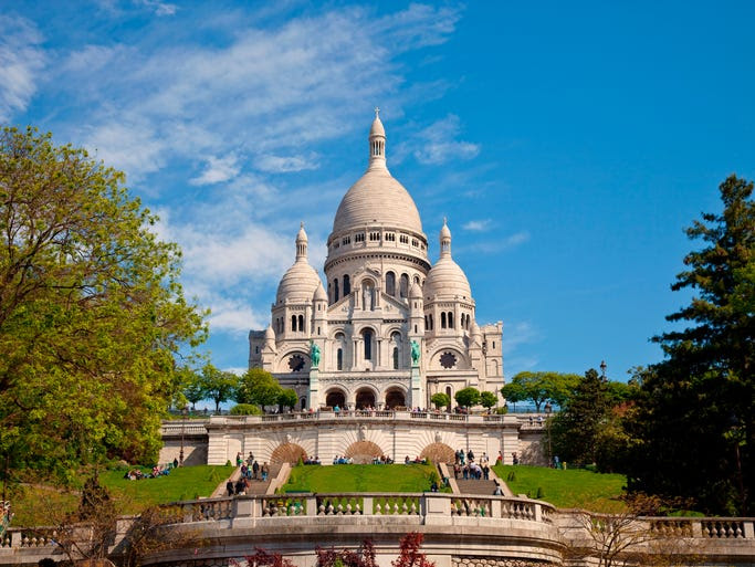 If                                                           there's one                                                           church in                                                           Paris as                                                           iconic as                                                           Notre Dame,                                                           it's the                                                           hilltop                                                           Sacre-Coeur                                                           Basilica on                                                             the summit of                                                           Montmartre.                                                           The                                                           Romano-Byzantine                                                           structure was                                                           built from                                                           travertine                                                           stone that                                                           exudes calcite                                                           when it rains,                                                           keeping the                                                           church pearly                                                           white.