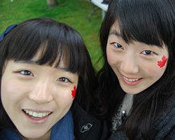 Students with Canadian flags face paint