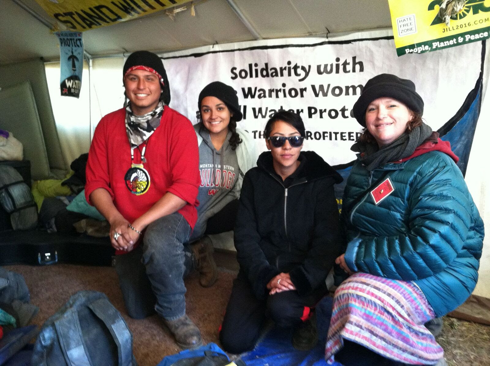 Members of the International Indigenous Youth Council and Gina Petry (right) with RW/FSP banner