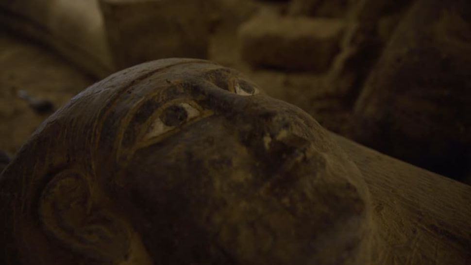 13 mummy coffins stacked in a well unearthed in ancient Egyptian necropolis