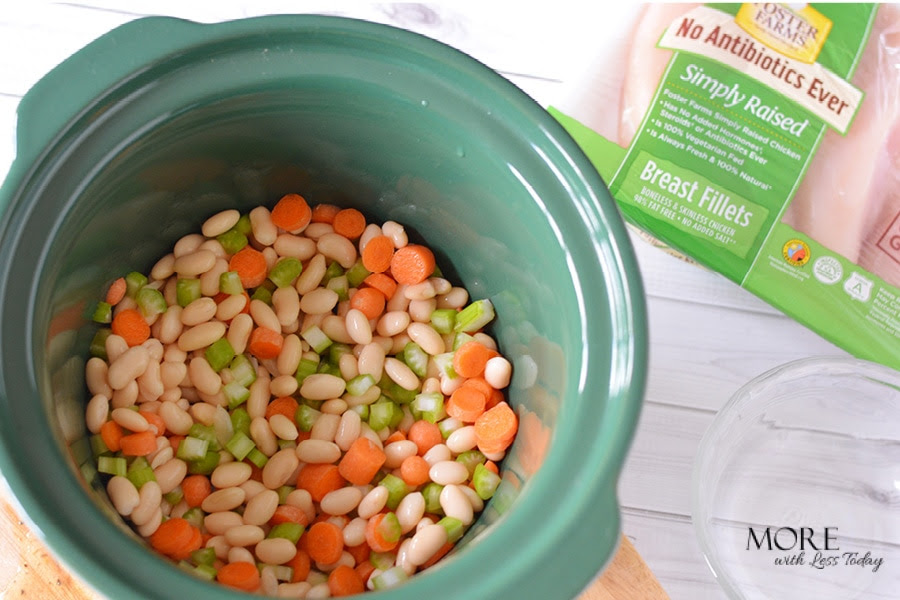 photo of beans inside crockpot to make Slow Cooker Chicken with Rosemary and White Beans recipe