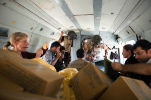 Pilots, journalists, and aid workers board a helicopter bound for Mount Sinjar on Aug. 12, 2014. (ADAM MIRANI)