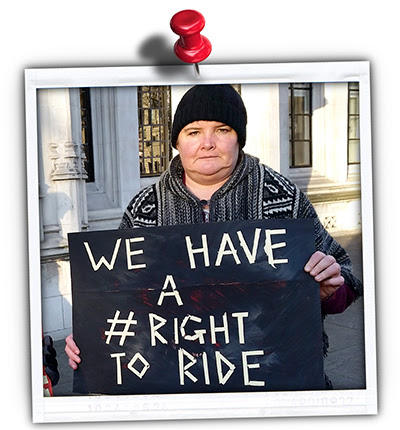 "Picture of a TfA member holding a sign saying ""We have a right to ride"""