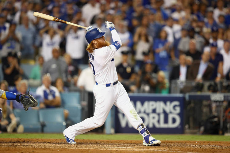 Justin Turner #10 of the Los Angeles Dodgers hits the winning home run in the bottom of the ninth inning during Game Two of the NLCS. (Ezra Shaw/Getty Images)