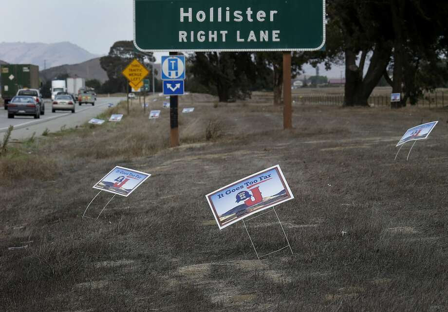 Anti-fracking forces claim that the oil industry is removing their signs from peoples yards and placing their own signs on public roads near Hollister, Calif. In the upcoming election, three California counties will vote on ballot measures to ban fracking (hydraulic fracturing) within their borders. San Benito County's measure would also ban cyclic steam injection and acidization methods. Photo: Brant Ward, The Chronicle