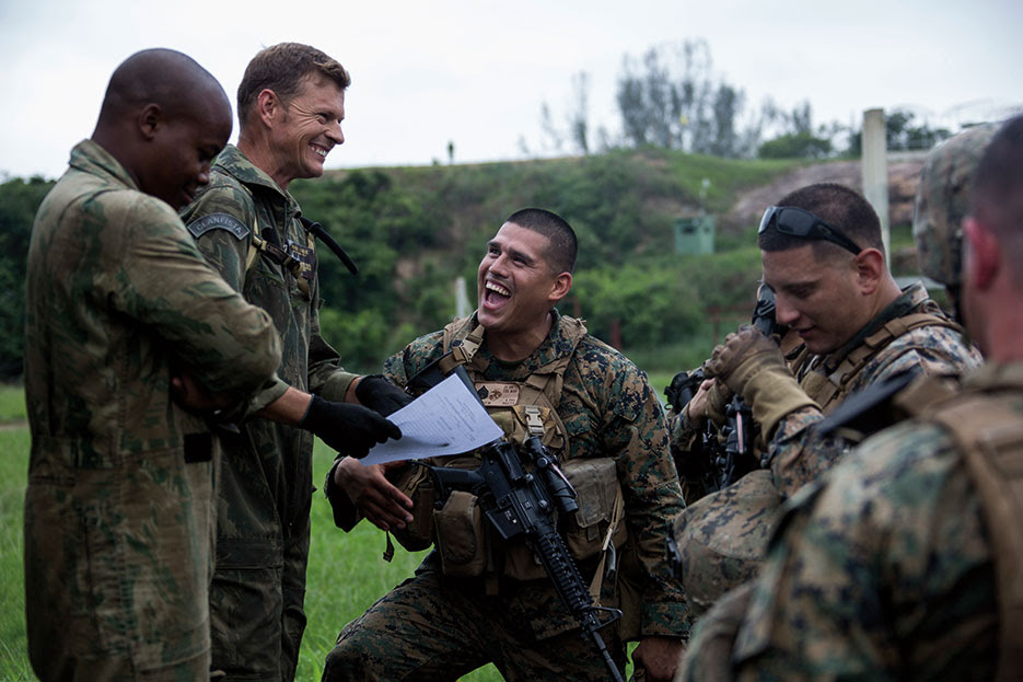 U.S. Marines with Golf Company, 23rd Marine Regiment, 4th Marine Division, Marine Forces Reserve, sign roster alongside Brazilian marine corps during UNITAS Amphibious 2015, Ilha do Governador, Brazil, November 16, 2015 (U.S. Marine Corps/Issac Velasquez)