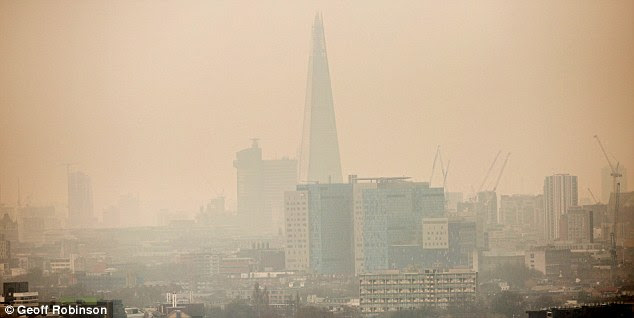 Blurred: The Shard, one of London's most iconic buildings, is pictured shrouded in 'blood rain' earlier this month