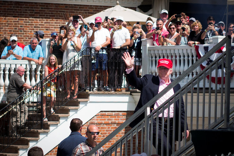 Trump waves to the crowd during the U.S. Women's Open golf tournament at his golf course in New Jersey. (Kelvin Kuo/USA Today Sports)
