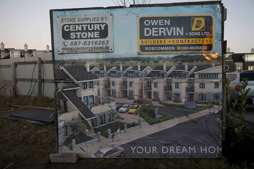 Broken dreams: A billboard which offered families the chance to buy their 'dream home' during the boom years stands as a painful reminder of  the recession