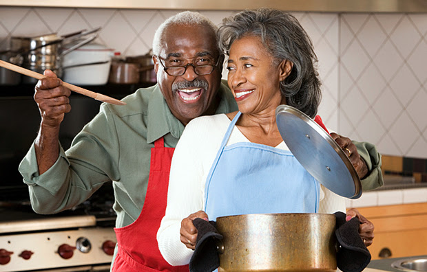 A senior couple cooking together.