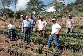 Root Capital staff visits farmer members of Soppexcca, a coffee farmer cooperative based in Nicaragua.