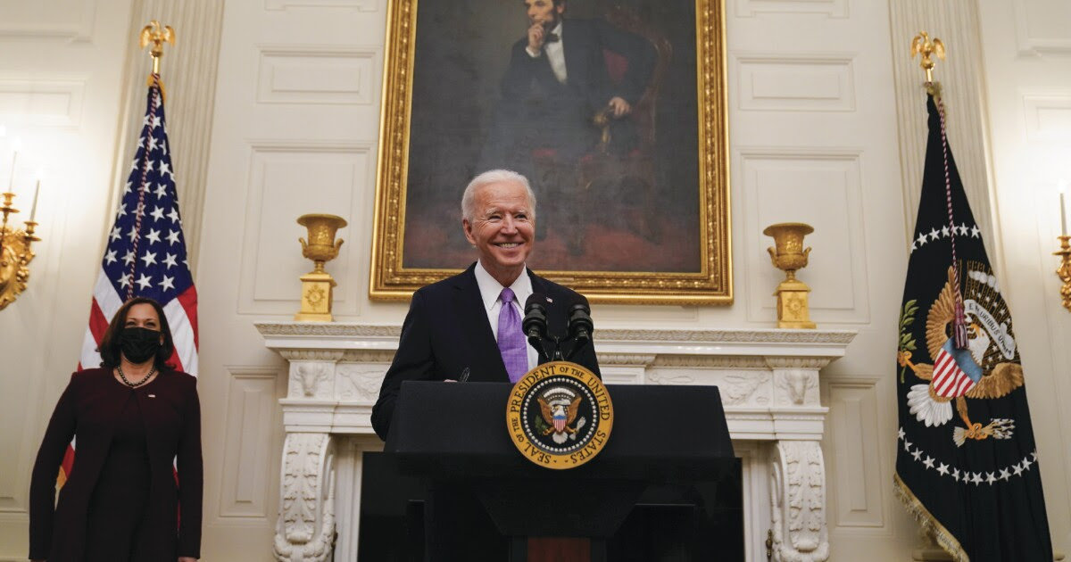 President Biden and Vice President Kamala Harris appear in a White House press conference.