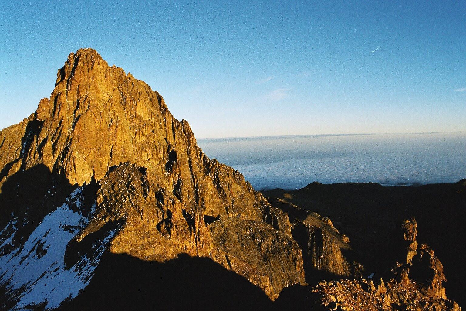 MT kenya Mount_Kenya wikipedia image of beautiful mount kenya with snow on one side shadows sunlight beautiful.jpg