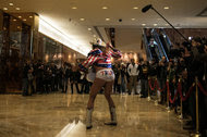 The Naked Cowboy performing last month in the lobby at Trump Tower, where Donald Trump was assembling his administration.