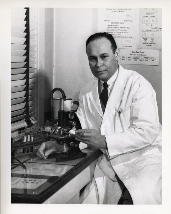HCharles Drew sits in his lab in front of a microscope, circa 1940-1941. Courtesy of the Moorland-Spingarn Research Center, Howard University Archives, Howard University, Washington D.C.