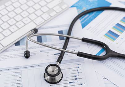 stethoscope sitting on top of medical charts