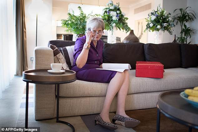 Britain's Prime Minster Theresa May is under pressure from ministers to set a timetable for departure. (pictured: preparing her keynote speak for conference)