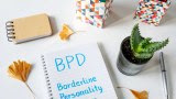 The words Borderline Personality Disorder written in notebook on white table