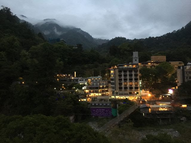Guguan at night - a small cluster of buildings surrounded by lush green mountains